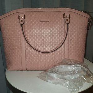 Large Gucci pink Microguccissima bag.